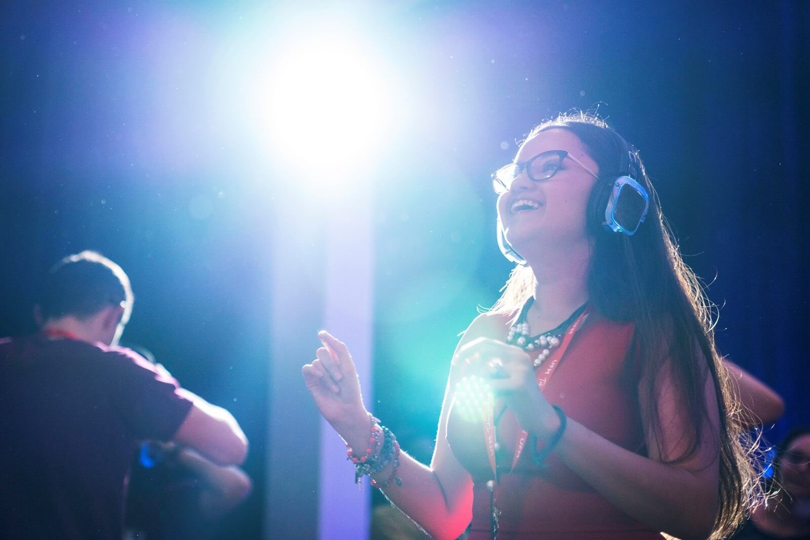 girl wearing headphones dancing at FEEcon 2019 silent disco